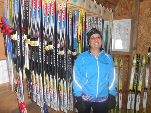 Michelle Hach proudly standing with our ski equipment.